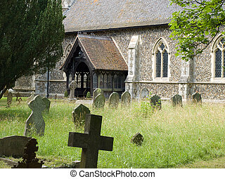 A graveyard alongside an English church