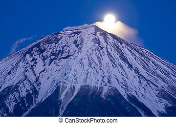 Moon Rising - The Moon rising over the peak of Mt Fuji at...