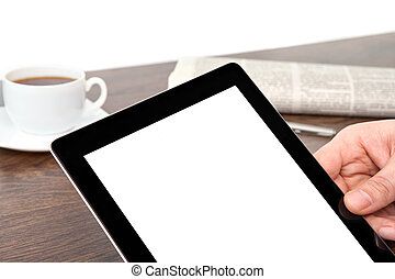 businessman hand holding a tablet with isolated screen against the background of the table in the office