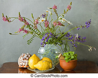 Meadow flowers in a vase, shell, lemons and herbs - Still...
