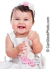 Portrait of smiling baby girl on a white background