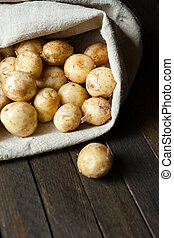 new potatoes in a linen sack, fresh food