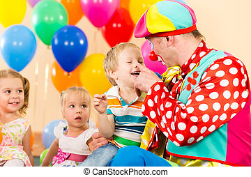 happy kid boy and clown on birthday party