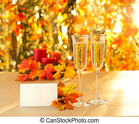 Champagne glasses for reception in front of autumn...