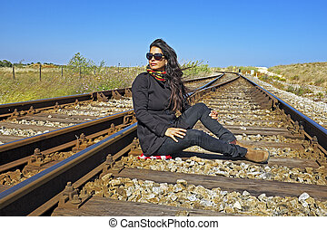 Beautiful young woman waiting for the train