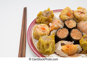 Chinese cuisine, steamed shrimp gyoza and dimsum on white...