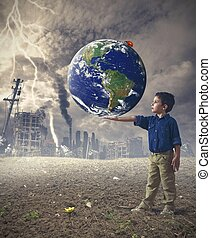 Save the world concept - Young boy holds the word. Concept...
