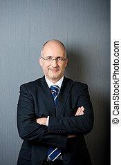 Portrait of a confident smiling mature businessman -...