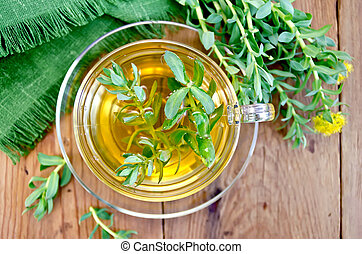 Herbal tea with Rhodiola rosea on the board - Healing herbal...
