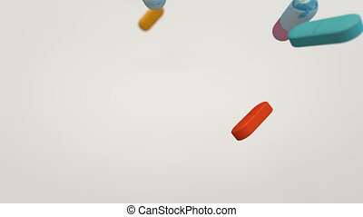 Capsules Falling - Animation of drugs falling down.