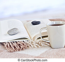 Relaxing reading with tea - Relaxing with a book and cup of...