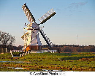 White windmill against blue sky - White Wooden Windmill in...