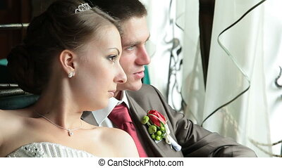 couple looking through the window - Wedding couple looking...
