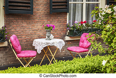 home terrace with table and chairs