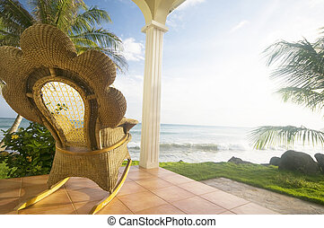 handmade wicker rocking chair on patio luxury resort hotel...