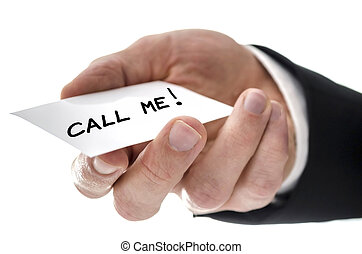 Closeup of a business man handing card with Call me message