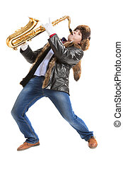 Man playing on saxophone - Young man in outerwear playing on...