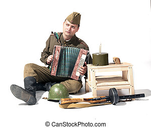 The soldier with the accordion near military tackles