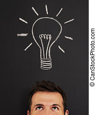 Man with light bulb above his head