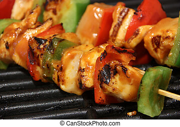 Chicken kebab on grill - chicken kebab with bell pepper on...