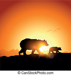 Wild Bears silhouetted against a sunset in the mountains