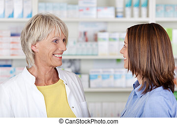 Friendly talk in the pharmacy between two females