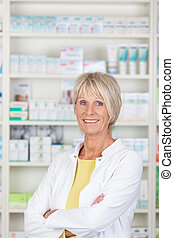 Friendly pharmacist with crossed arms