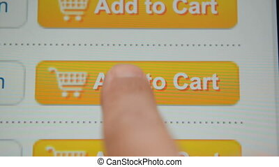 Add to Cart button - Finger touching Add to Cart button on a...