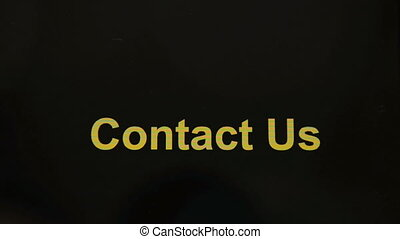Contact Us button - Finger touching Contact Us on a tablet...