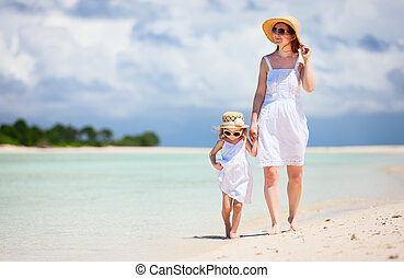 Mother and daughter at beach - Beautiful mother and little...