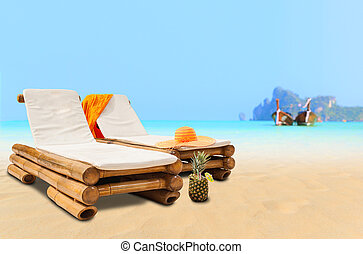 Straw hat on sunbed on Koh Phi Phi Island in Thailand