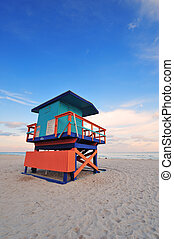 Miami South Beach sunset with lifeguard tower and coastline...