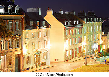 Old buildings on street at night in Quebec City