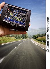 GPS in a man hand - GPS Vehicle navigation system in a man...