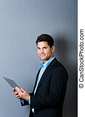 A businessman holding a tablet computer - Portrait of a well...