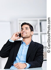Businessman Using Mobile Phone While Looking Up - Happy of...