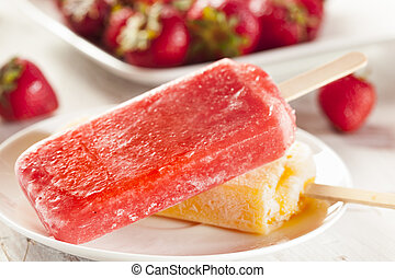 Cold Organic Frozen Strawberry Fruit Popsicle with a stick