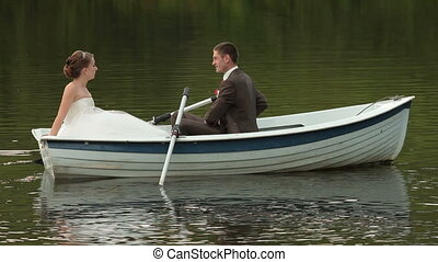 Bride and groom on floated boat