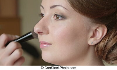 Final touch of a great makeup - Makeup artist helped the...