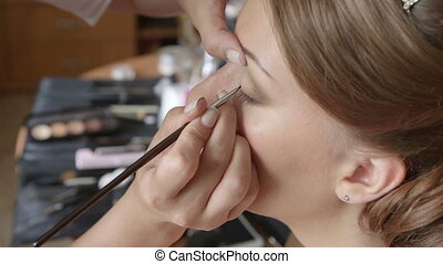 Bride Having Eye Makeup Applied