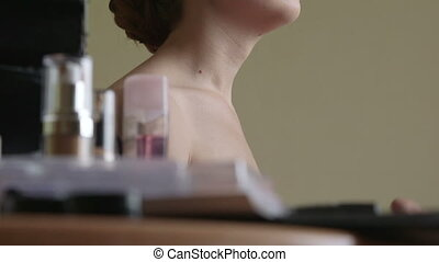 Makeup artist applying foundation - Makeup artist helped the...