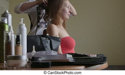 Making coiffure - Stylist pinning up a brides hairstyle...