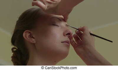 Bridal make up - Makeup artist helped the bride in getting...