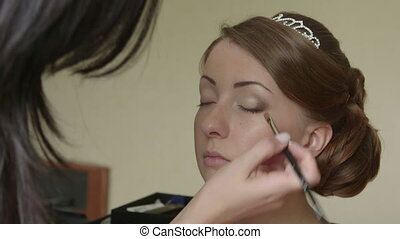 Bride getting face make up