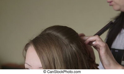 Hair Salon - Young woman getting hair style at hairdresser