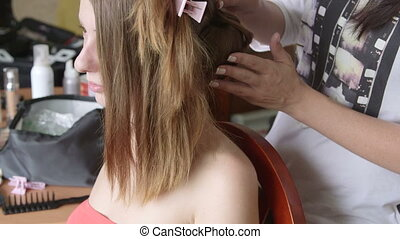 Hairdresser at work - Stylist pinning up a brides hairstyle...