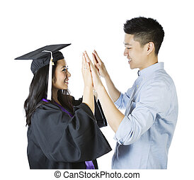 Young Adult Couple expressing happiness upon graduation