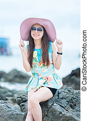 A portrait of beautiful asian woman on the seashore