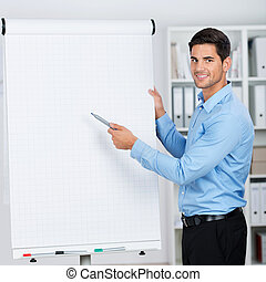 Businessman presenting a flipchart with a smile - Young...