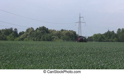 agriculture tractor spraying crop